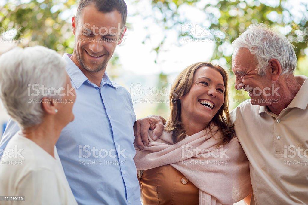 Granparents and parents having fun stock photo