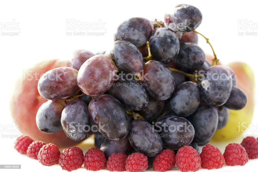 Grape and raspberries stock photo
