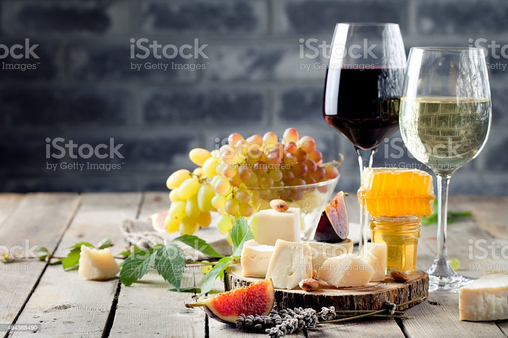 Grape, cheese, figs and honey with a glasses wine. stock photo