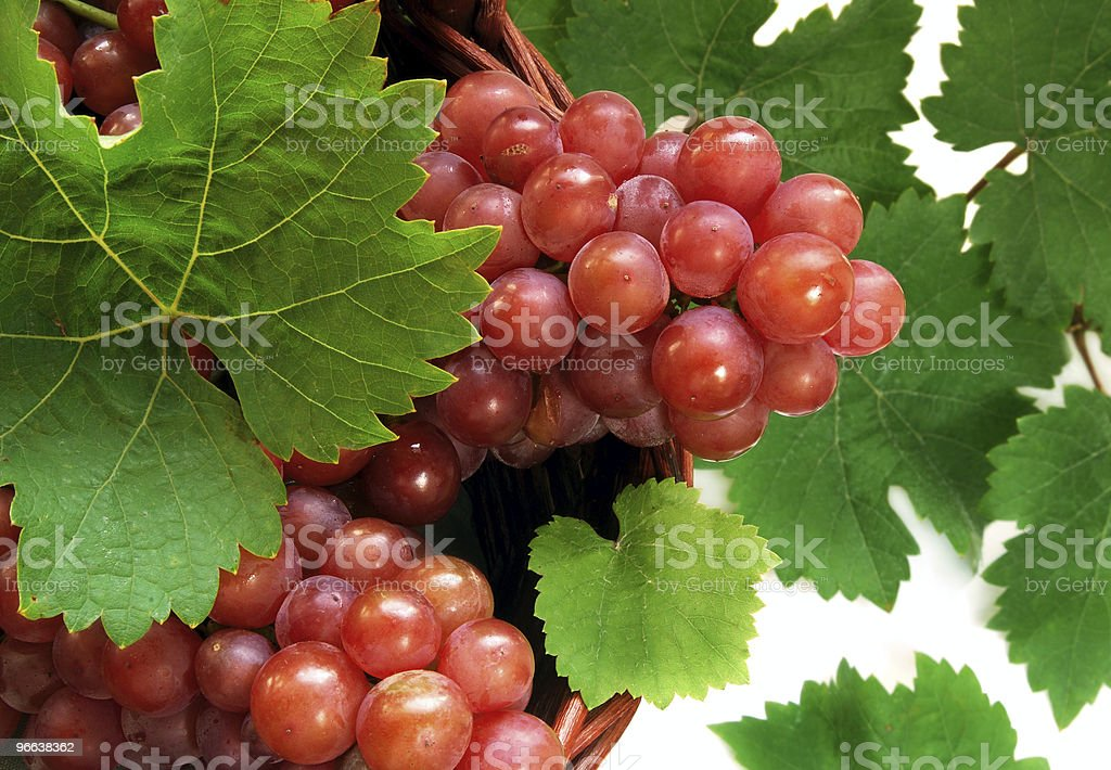 Grape clusters in basket royalty-free stock photo