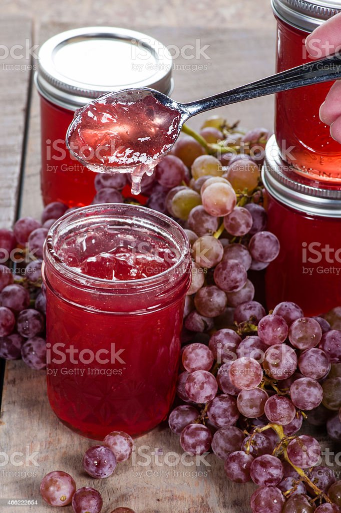 Grape jelly with bunches of grapes stock photo