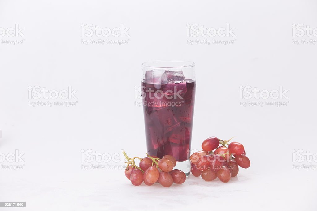 Grape juice in a glass with ice. stock photo