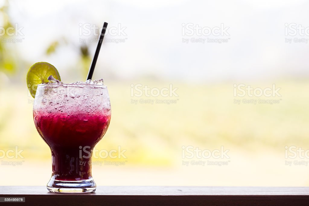 Grape juice with lime soda stock photo