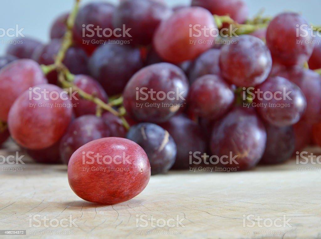 grape on wooden chop block stock photo