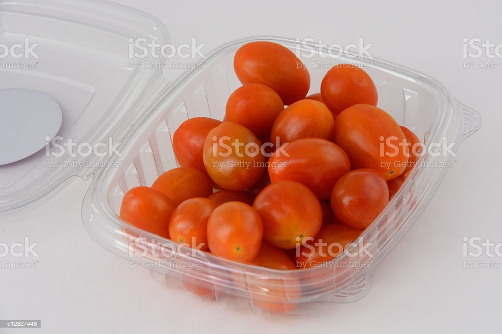 Grape tomatoes in plastic packaging stock photo