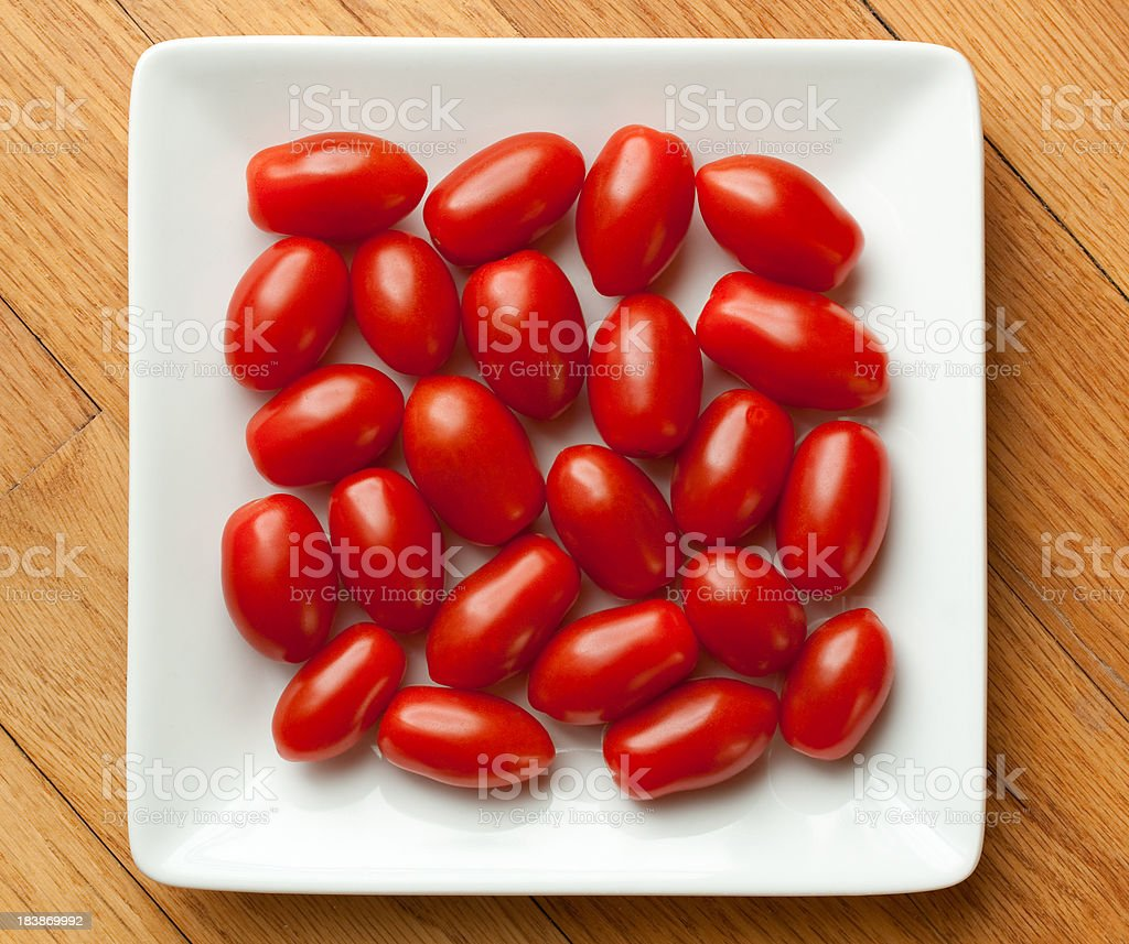 Grape Tomatoes on White Square Plate stock photo