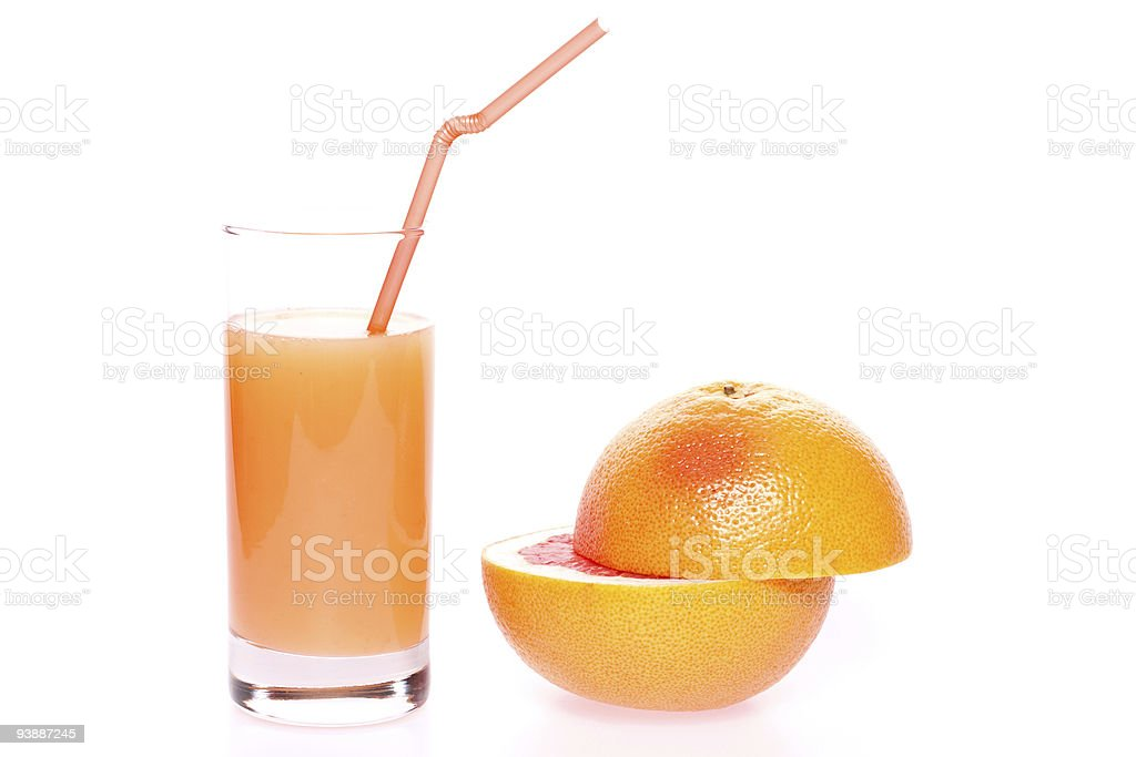 grapefruit and juice in glass stock photo
