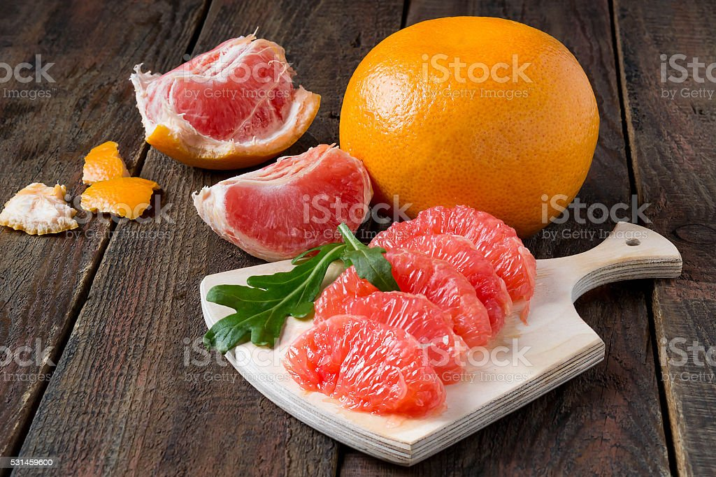 Grapefruit and peeled cloves salad stock photo