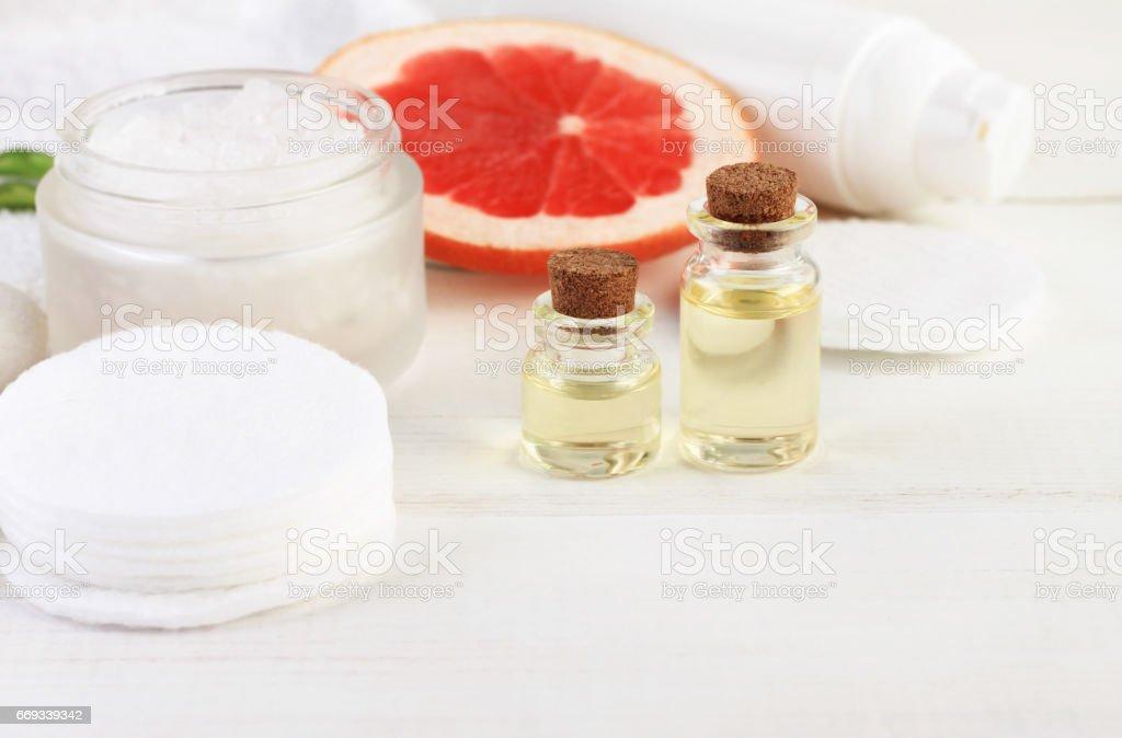 grapefruit essential oils, white copyspace stock photo
