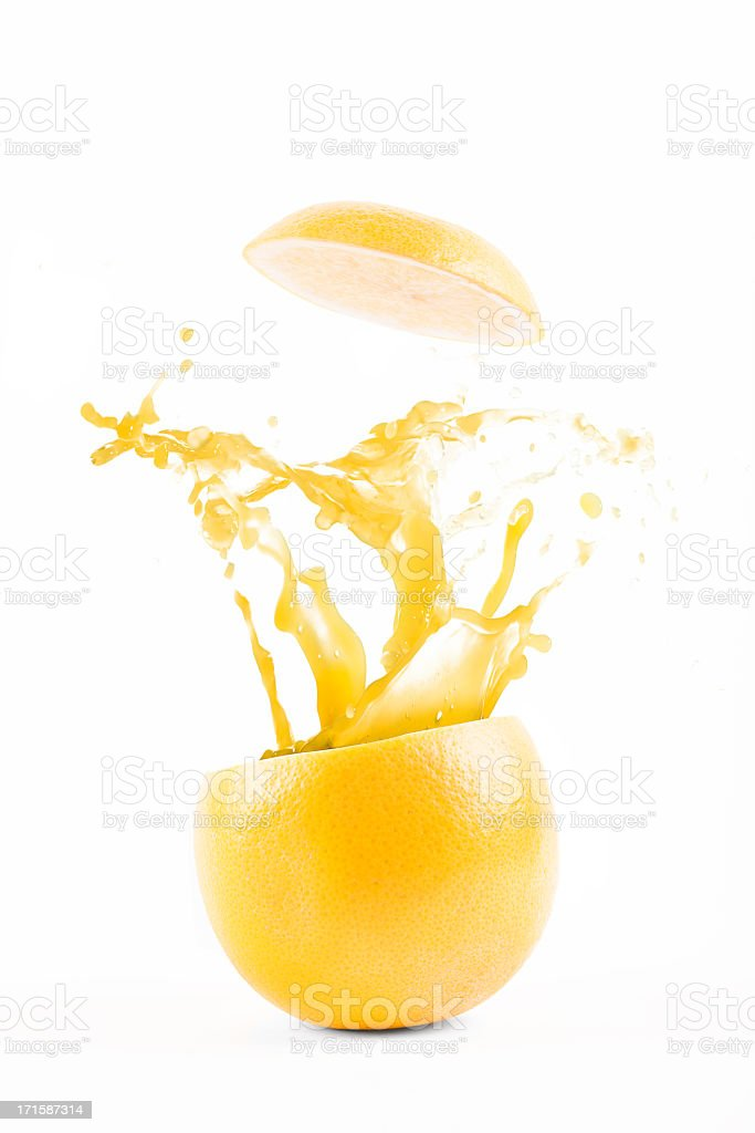 Grapefruit explosion juice splash stock photo