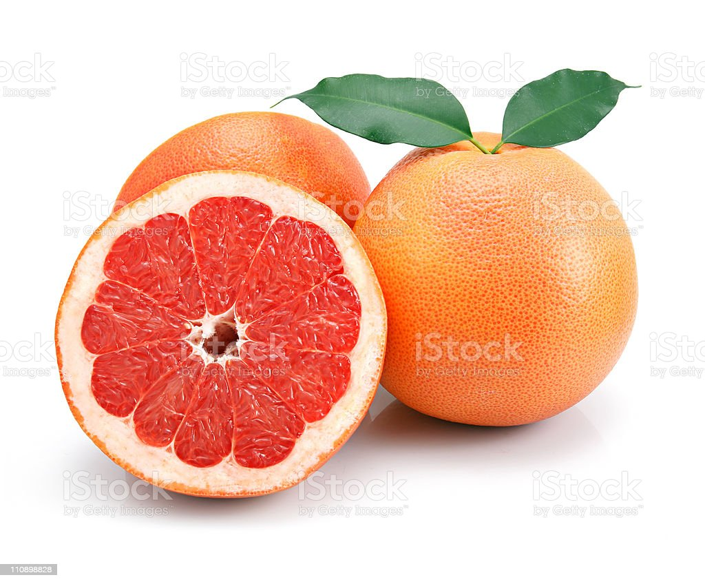 Grapefruit fruits with cuts and green leaf isolated stock photo