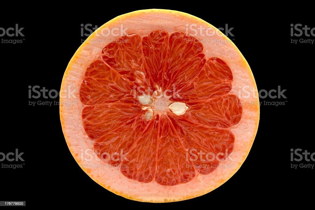 Grapefruit isolated on black background stock photo