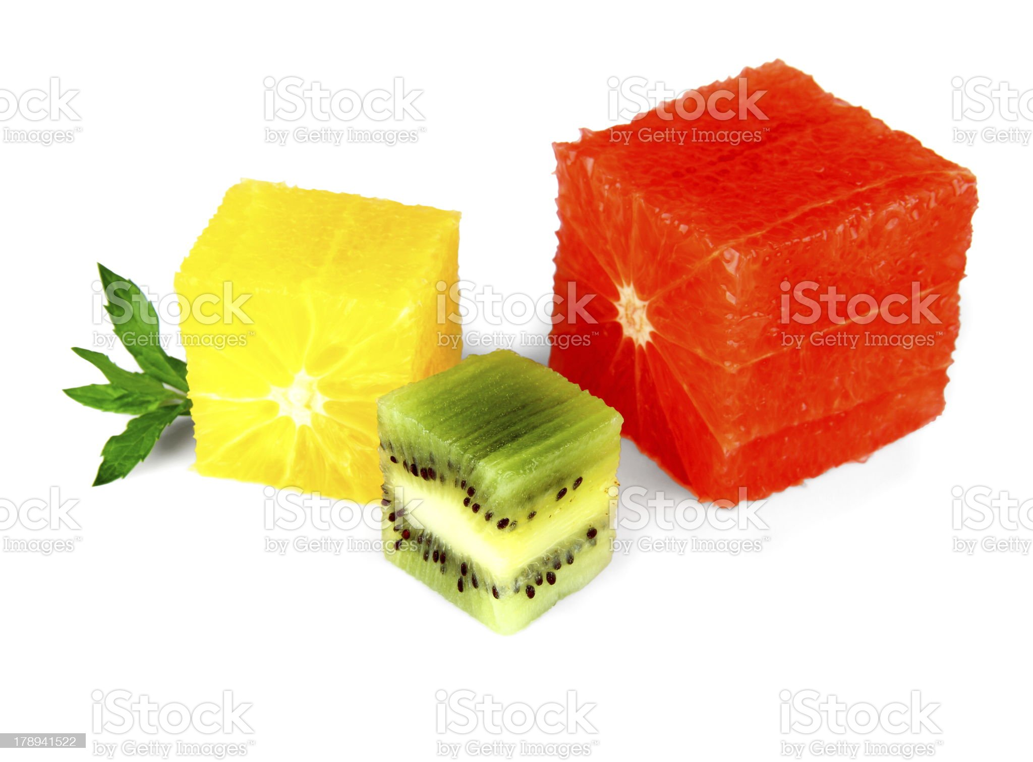 Grapefruit, oranges and kiwi cube with mint royalty-free stock photo