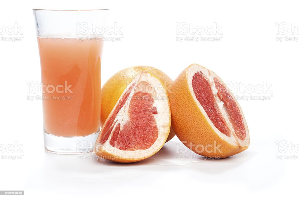 Grapefruit pieces and juice in a glass, isolated on white royalty-free stock photo