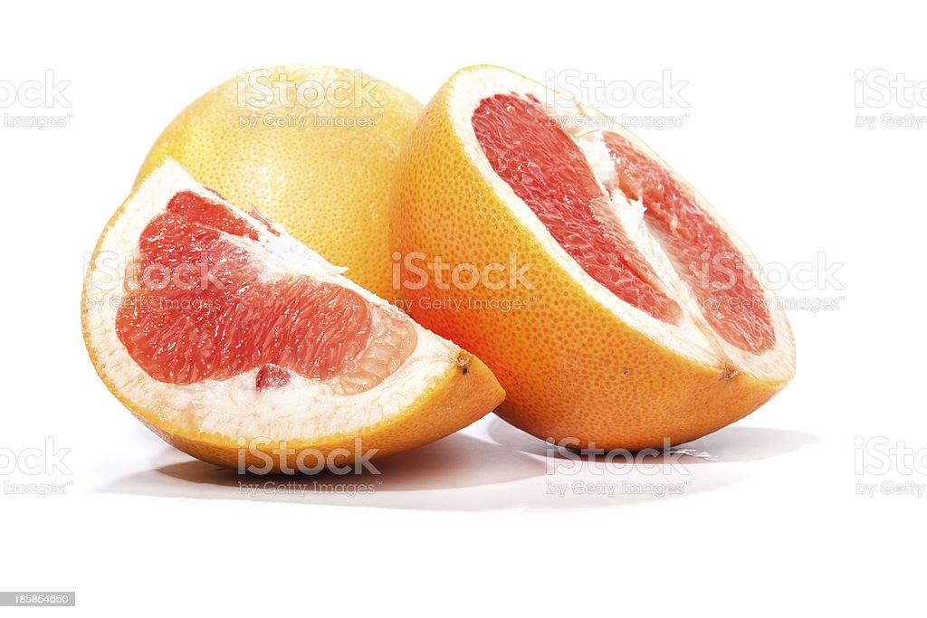 Grapefruit, pieces cut apart, isolated on white royalty-free stock photo