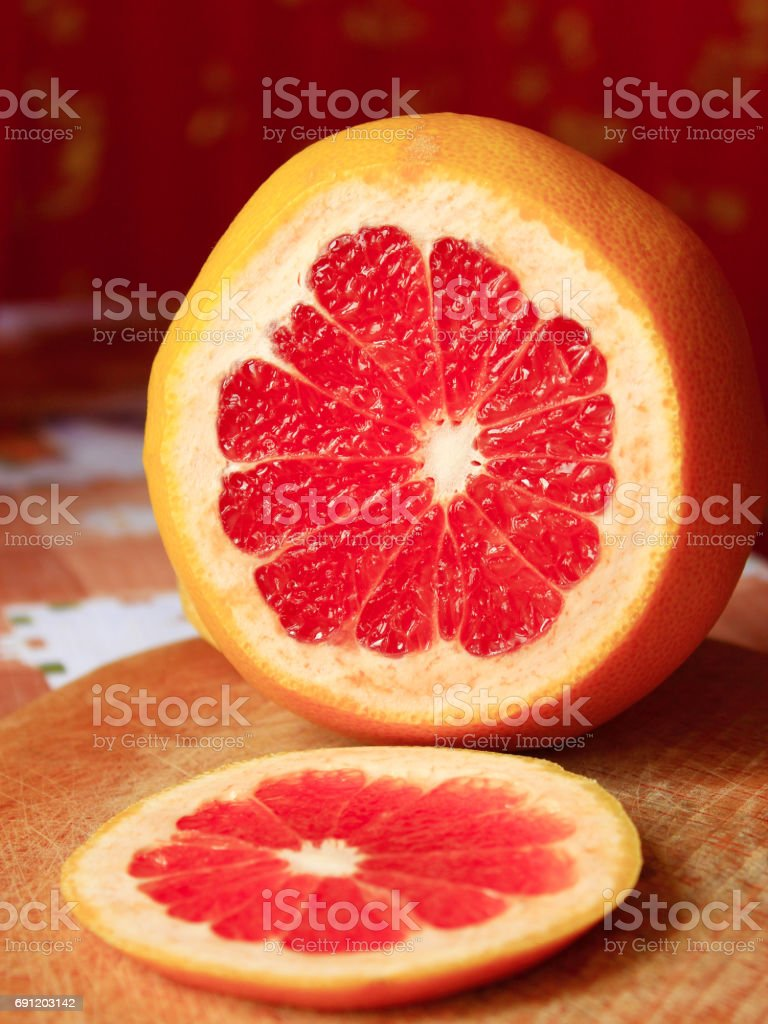 grapefruit red cut by piece stock photo