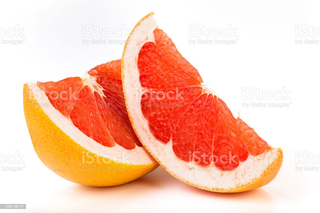Grapefruit slices isolated on white background stock photo