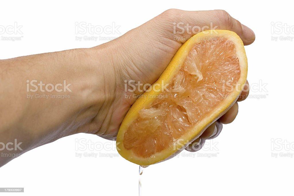 grapefruit squeezing royalty-free stock photo