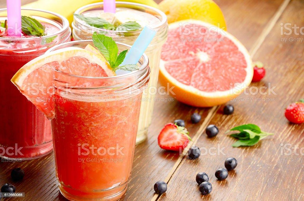 Grapefruit strawberry and banana smoothie stock photo