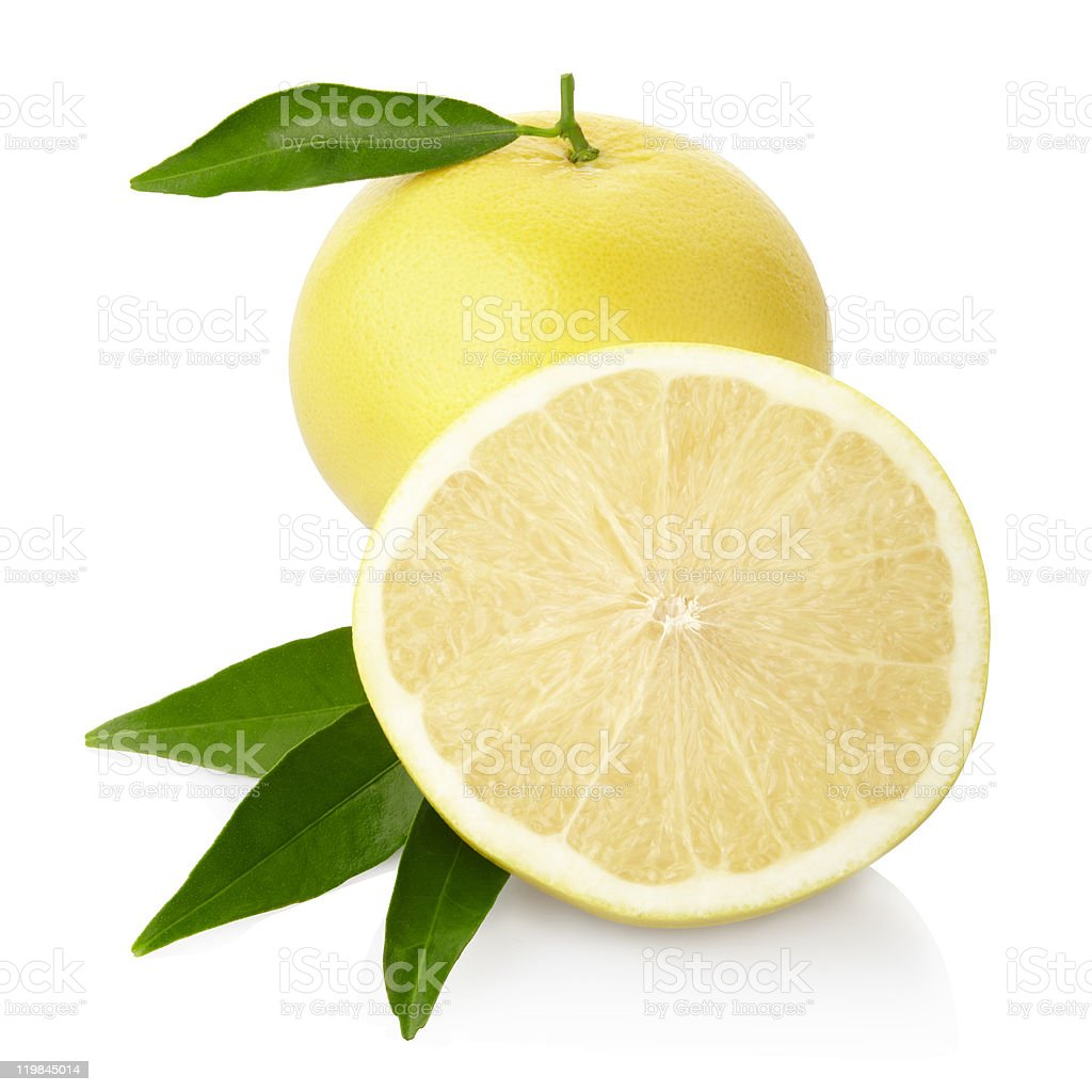 Grapefruit with leaves in white background royalty-free stock photo