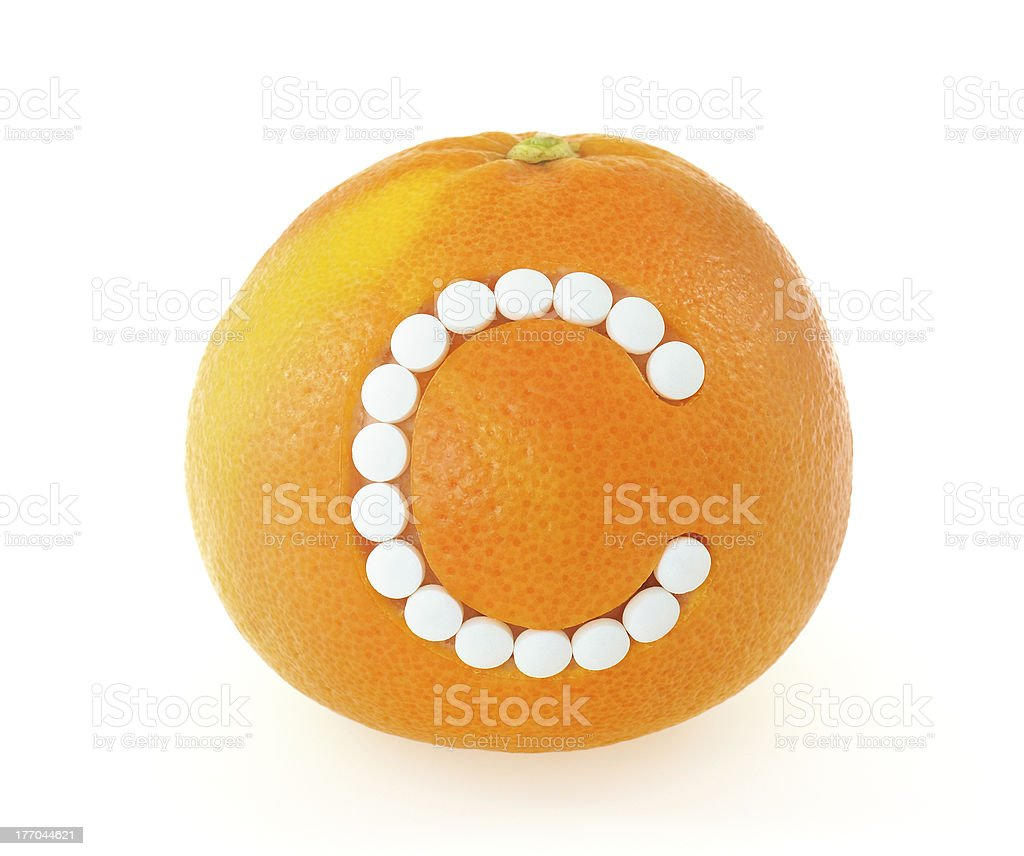 Grapefruit with vitamin c pills over white background - concept stock photo