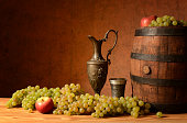 Grapes, a carafe for wine
