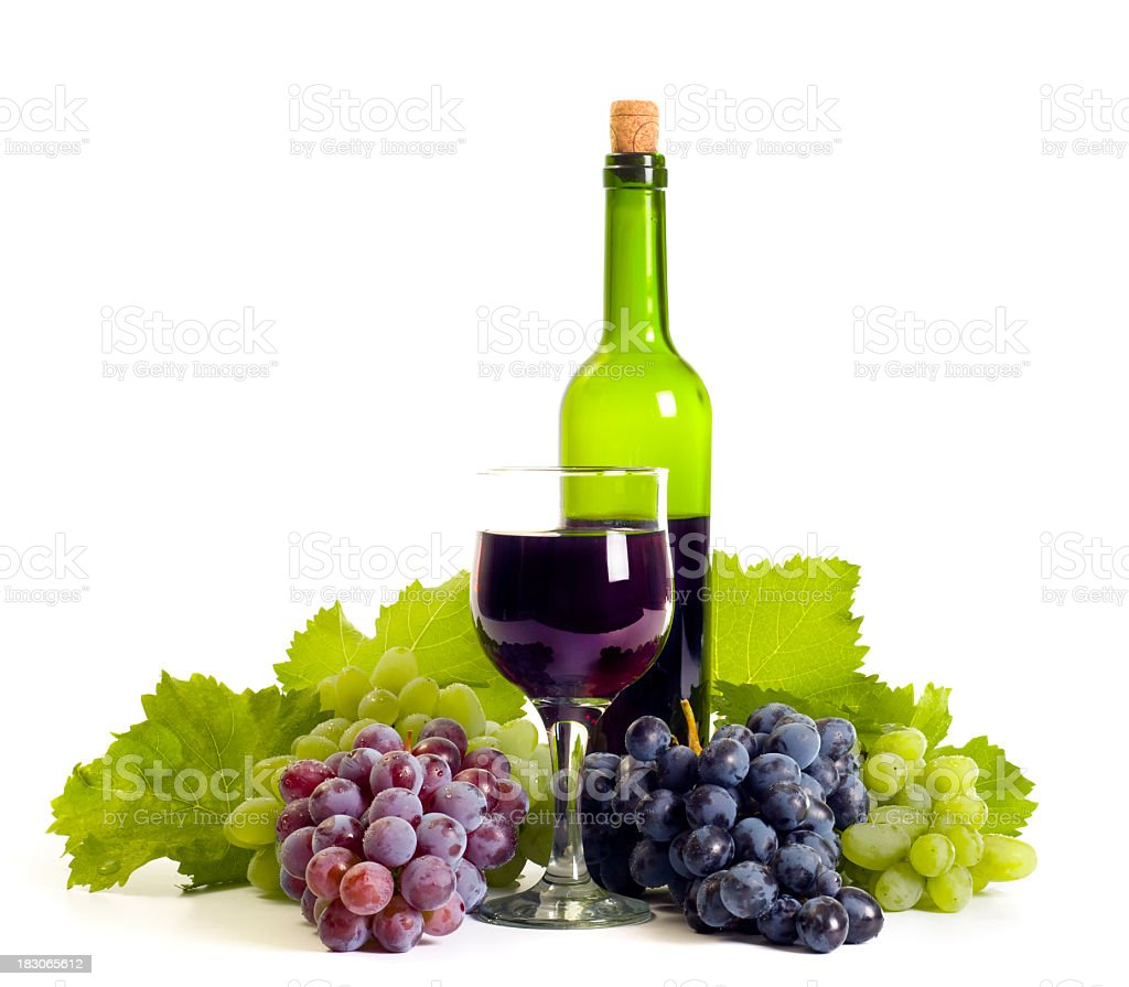 Grapes, a glass of wine and a bottle of wine composition stock photo