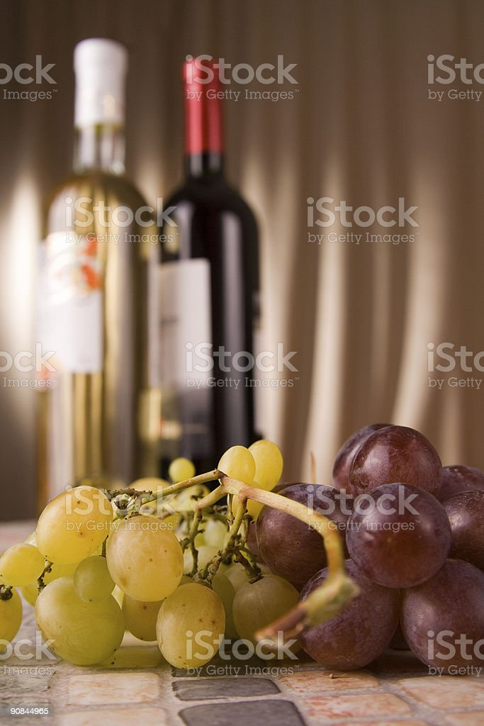 Grapes and botles stock photo