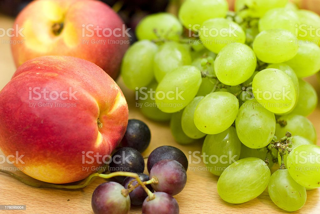 grapes and peaches fruits royalty-free stock photo