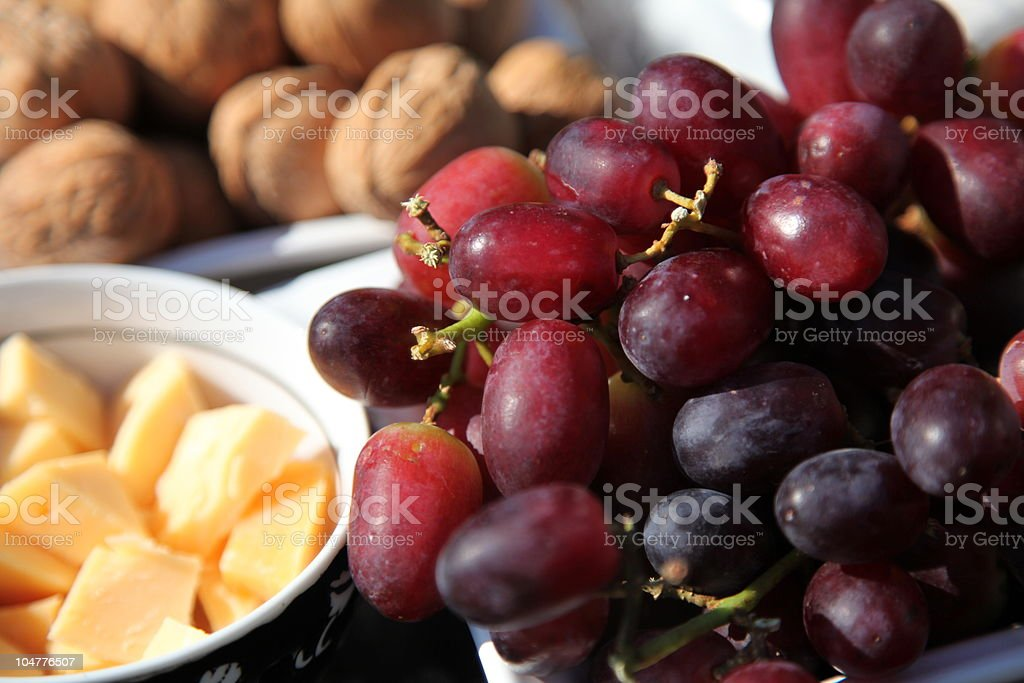 Grapes, cheese and walnuts stock photo