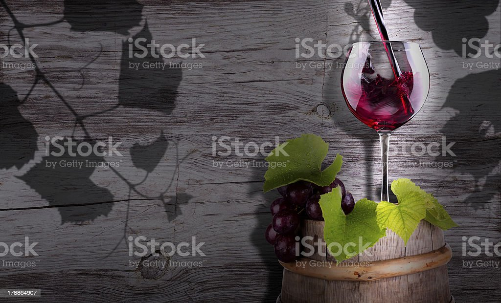 grapes, corkscrew and wine glass on a wooden vintage barrel royalty-free stock photo