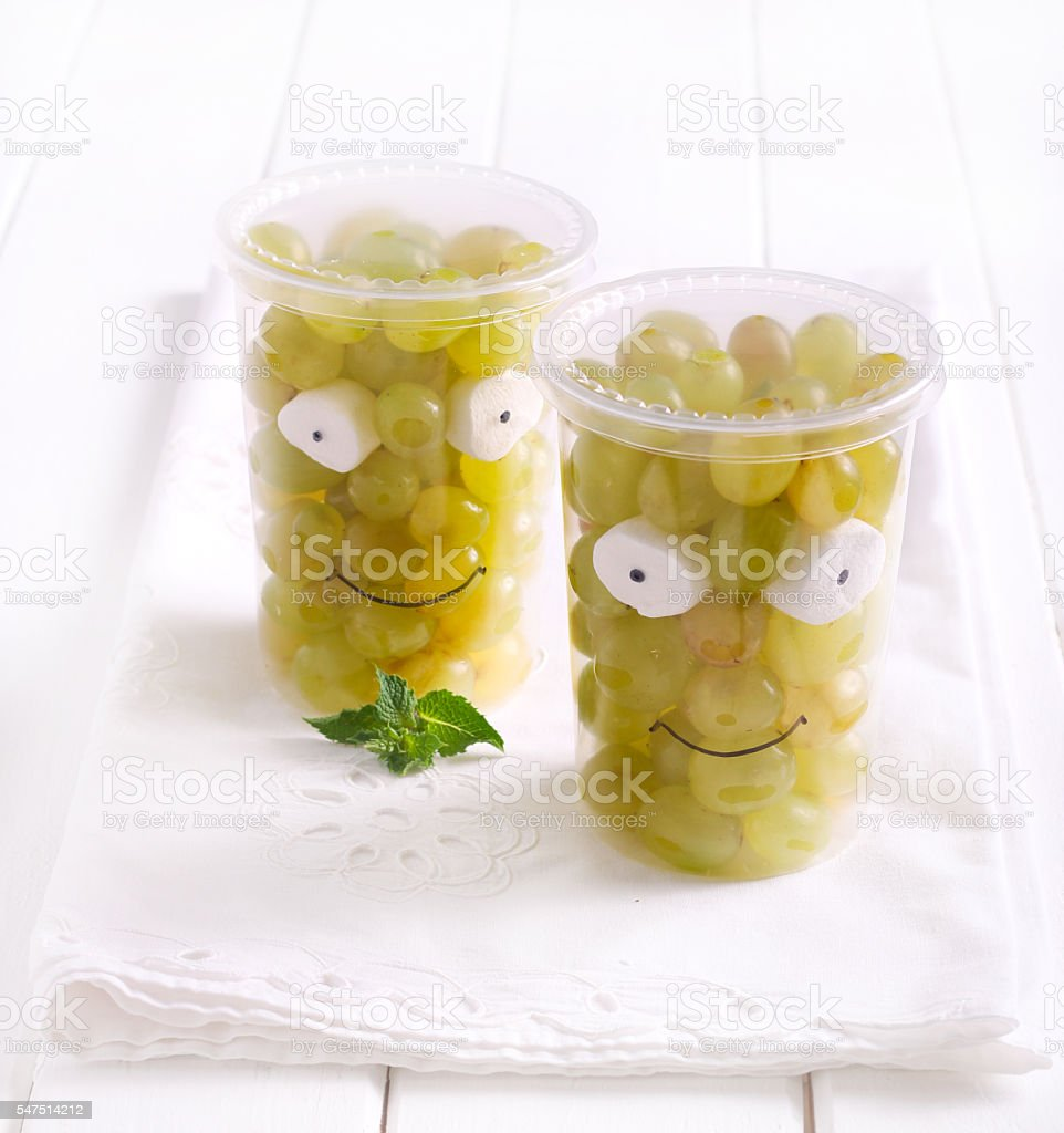 Grapes in cups, decorated Little Frankies stock photo