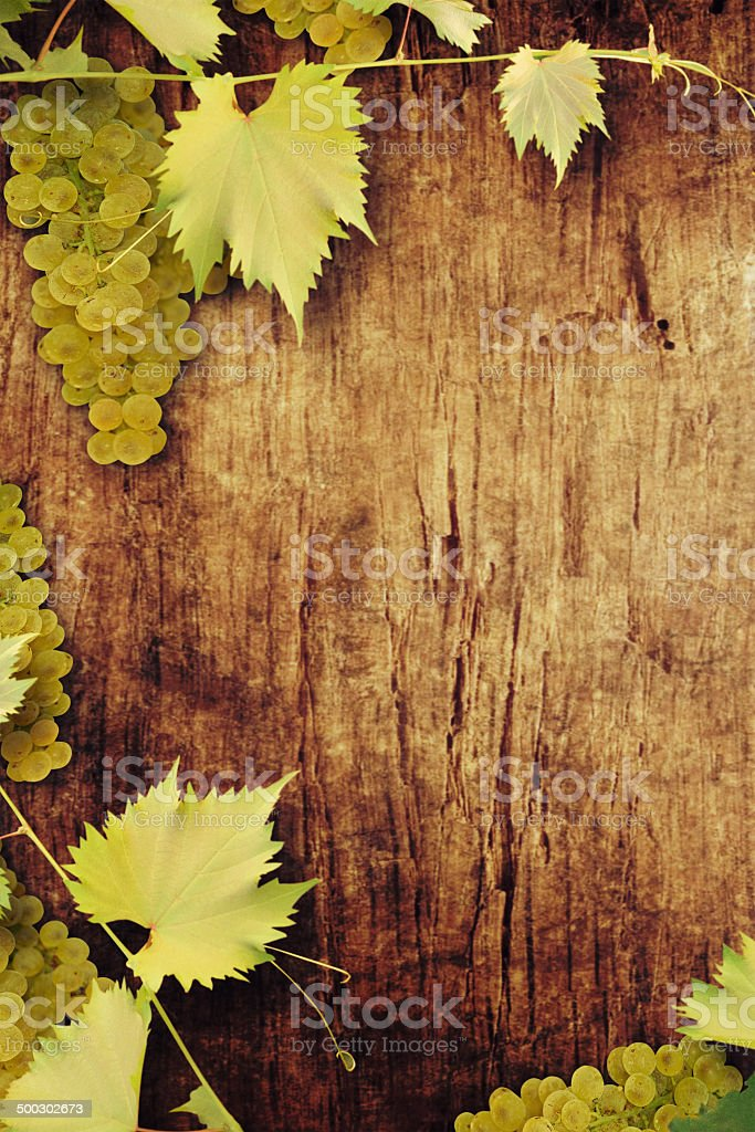 Grapes on a wooden background stock photo