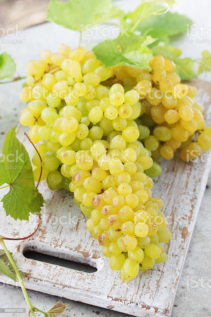 grapes on a wooden board stock photo