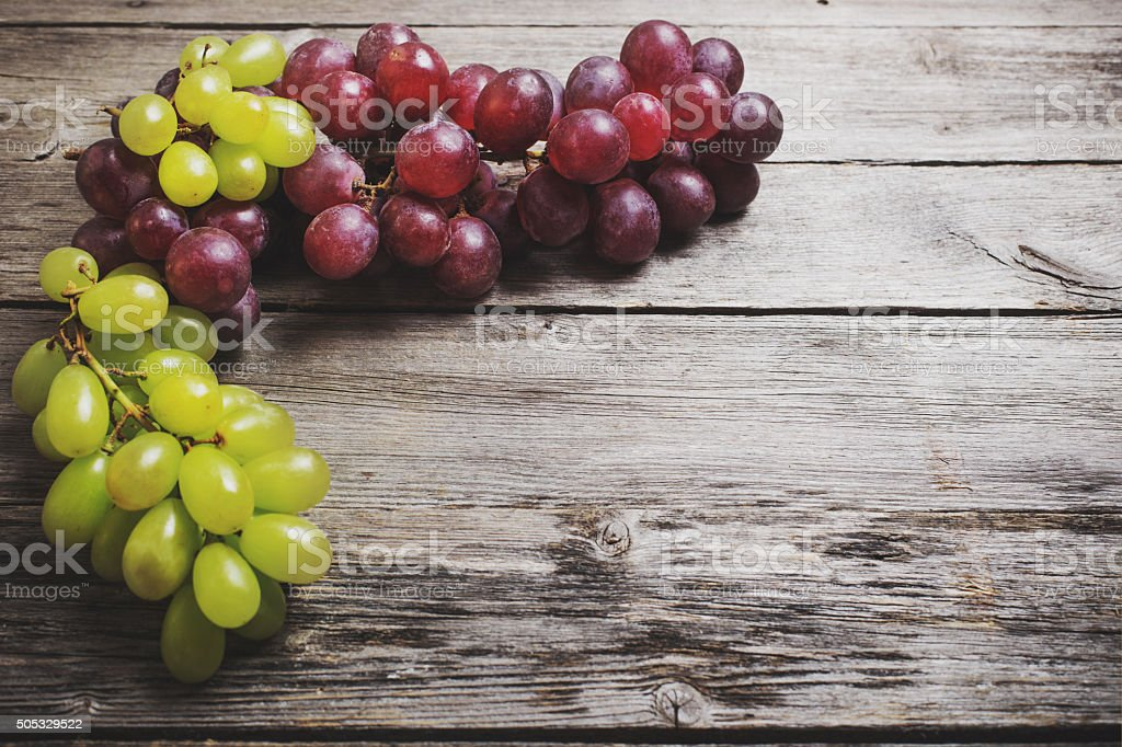 Grapes on a wooden table stock photo