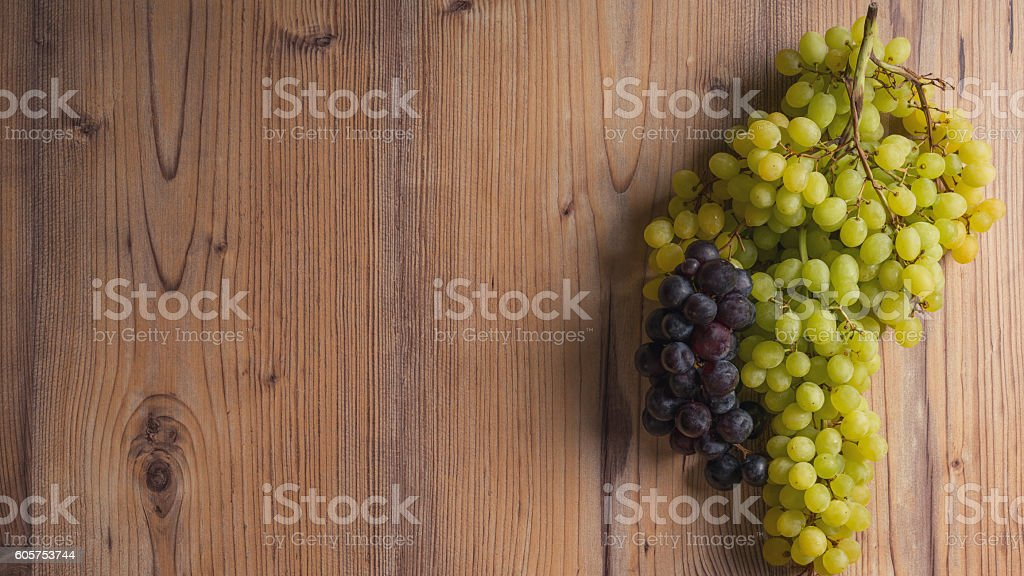 Grapes on the wood table stock photo