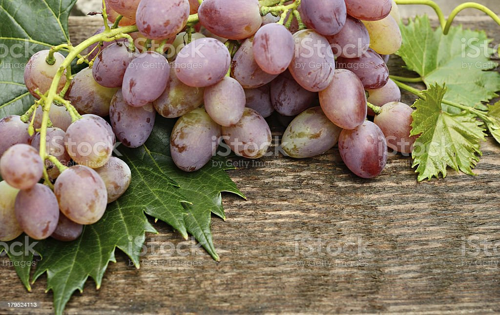 Grapes on wooden background royalty-free stock photo