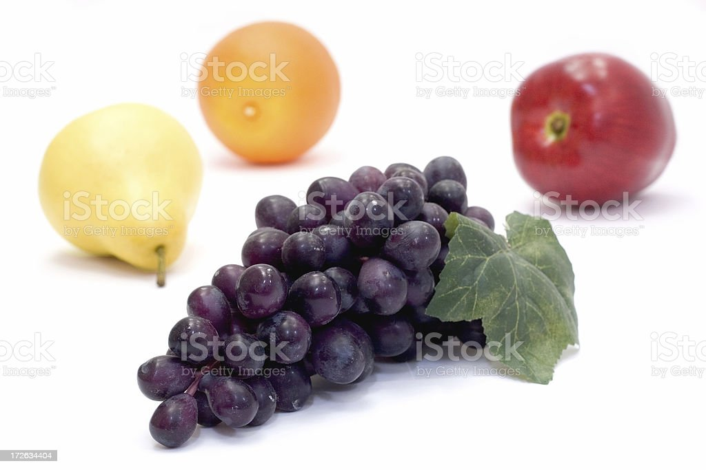 Grapes with a pear, orange and apple royalty-free stock photo