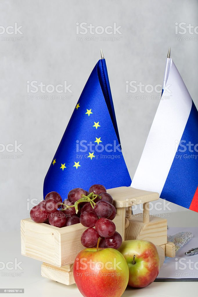 Grapes,apples and wooden made truck. stock photo