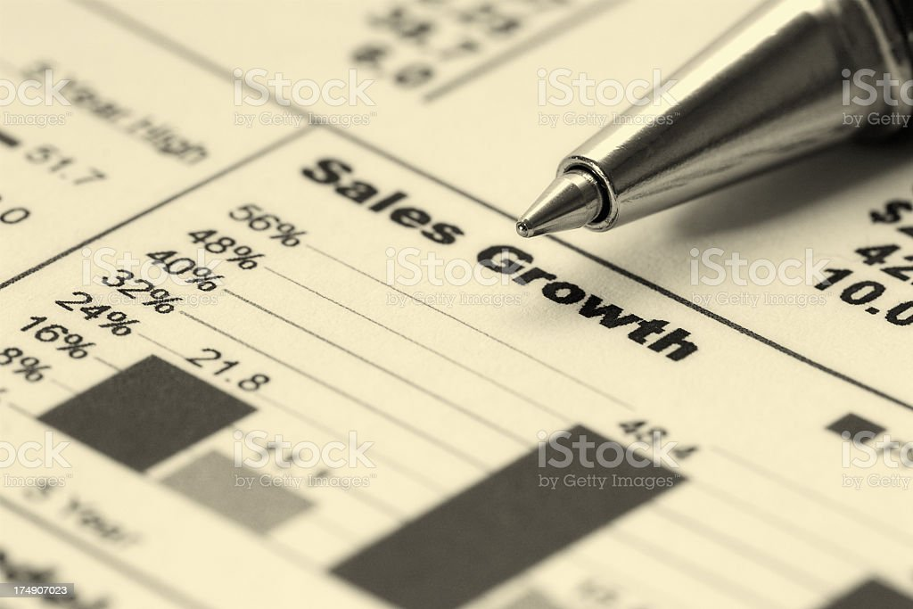 A graph displaying sales growth for a business with a pen royalty-free stock photo