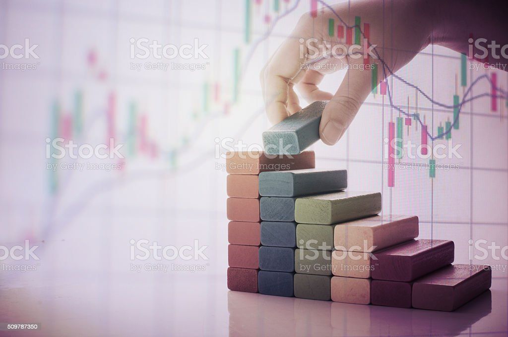 graph from block wood with hand and money concept stock photo