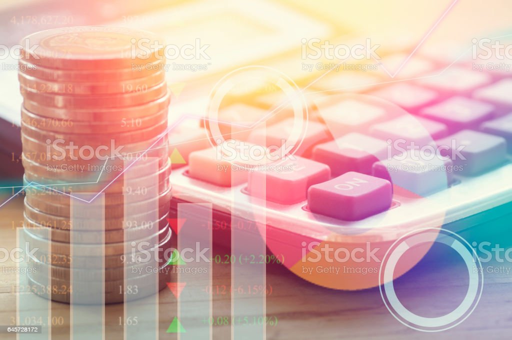graph on rows of coins for stock market stock photo