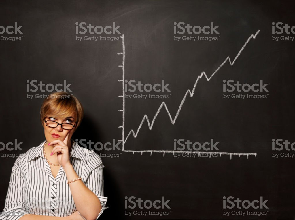 Graph on the Blackboard with a Puzzled Businesswomen royalty-free stock photo