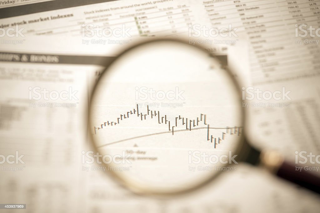 Graph Under Magnifying Glass royalty-free stock photo