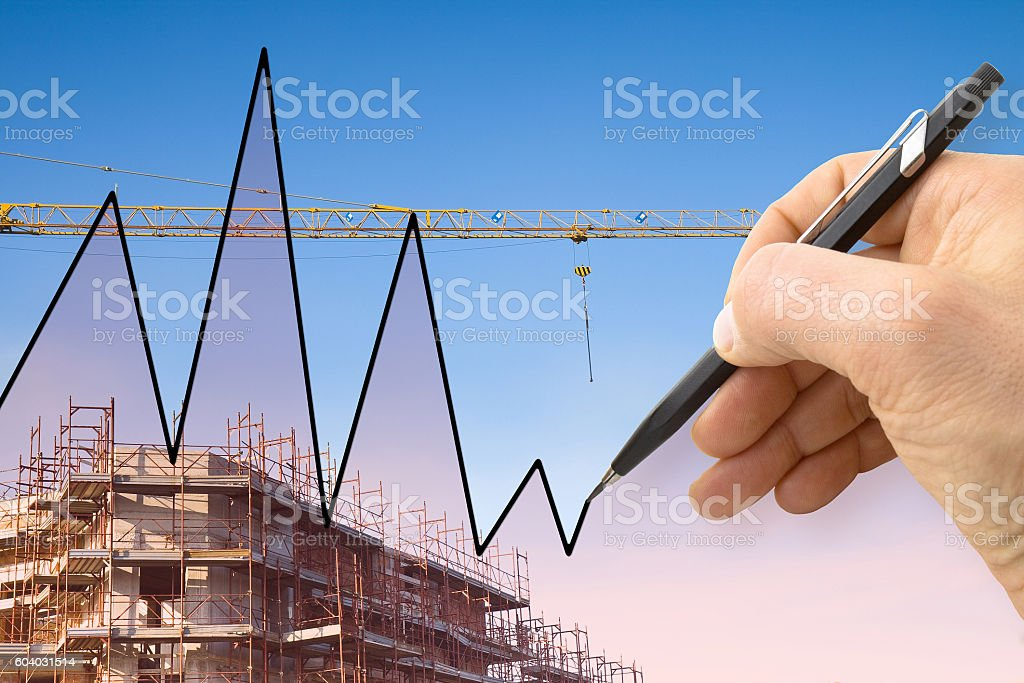 Graph with a background of a construction site stock photo