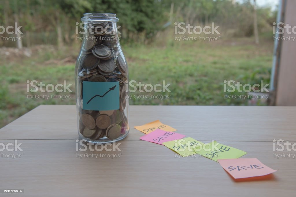 graph Writing in the paper, Coins in a glass jar stock photo