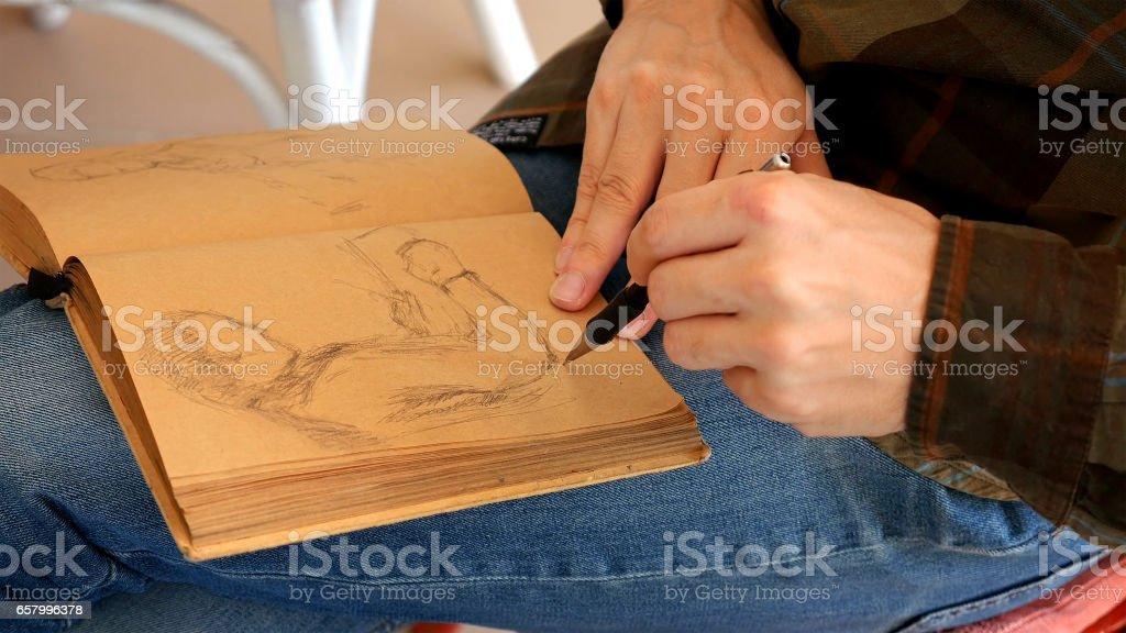 Graphic artist draws sketch picture artwork manual stock photo