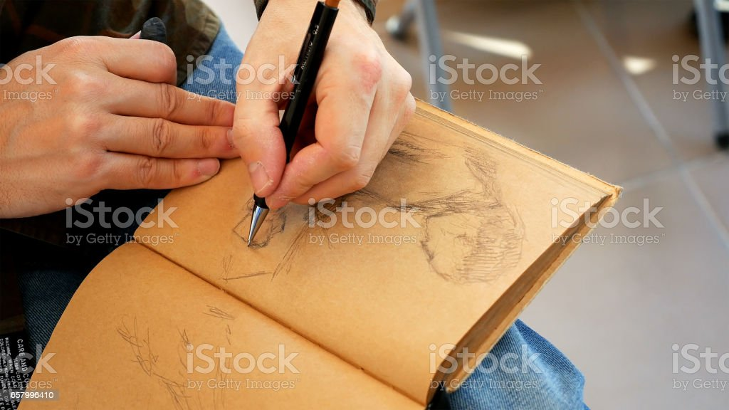 Graphic artist draws sketch picture artwork manual stock photo