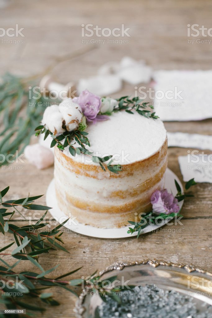 Graphic arts of beautiful wedding calligraphy cards and round cake with floral decorations. stock photo