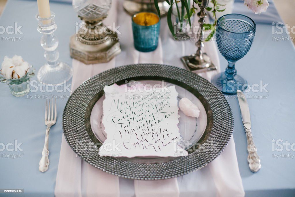 Graphic arts of beautiful wedding calligraphy cards and silver plate. stock photo